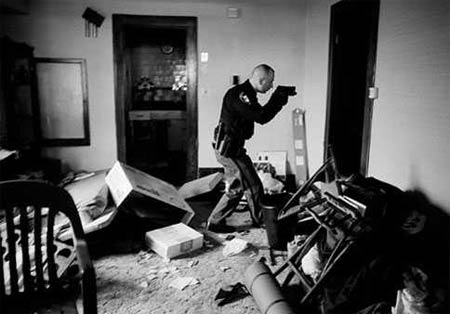 US Economy in Crisis: Following eviction, Detective Robert Kole must ensure residents have moved out of their home, Cleveland, Ohio, 26 March